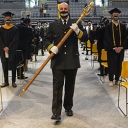 Johnny Brown, captain of operations for Appalachian State University's Appalachian Police Department, carries the university mace during one of App State's 13 in-person Spring 2021 Commencement ceremonies, held May 7–12 in Holmes Convocation Center on App State's campus. Photo by Marie Freeman