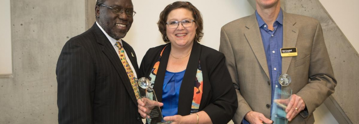 Dr. Jesse Lutabinga, Associate Vice Chancellor for International Education and Devlopment with Dr. Suzi Mills and Mr. Rich Campbell.