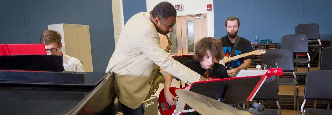 Hayes School of Music faculty member and students in jazz classroom