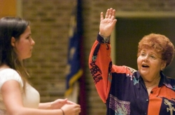 Janet Bookspan (drama coach and opera director) leads a master class.